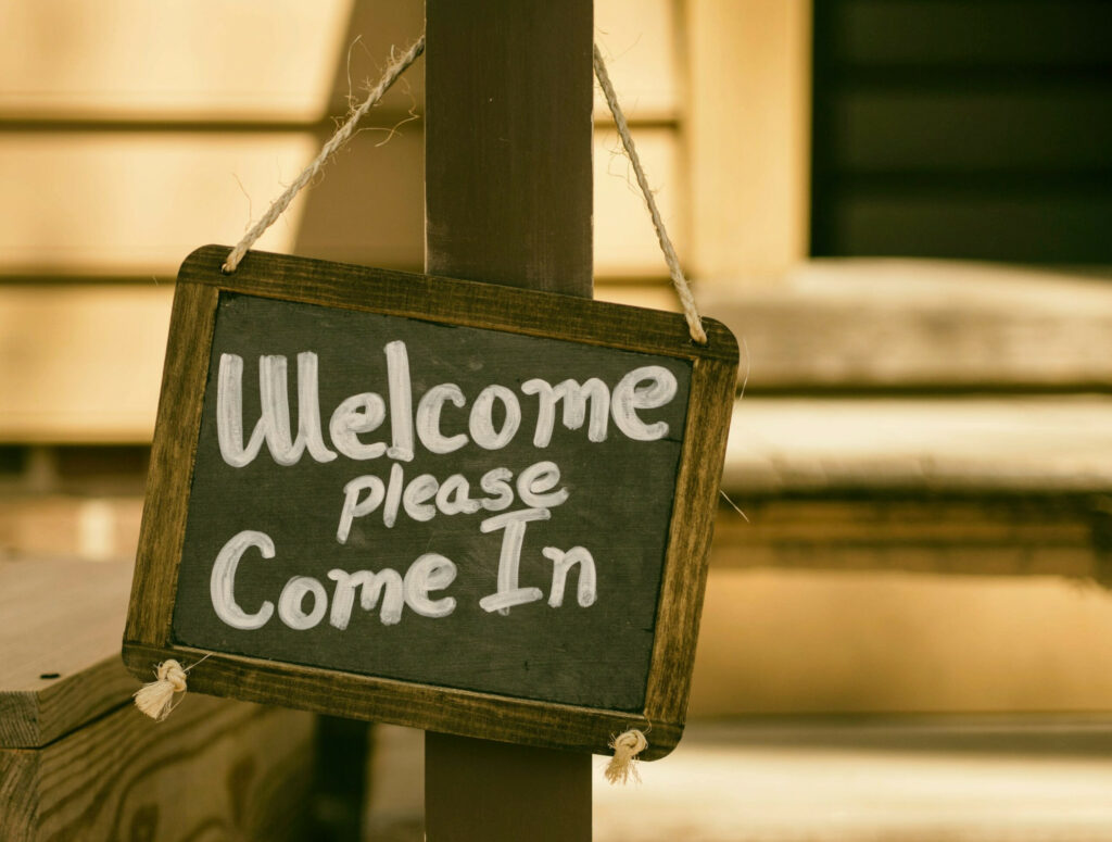 A chalkboard that reads Welcome, please come in