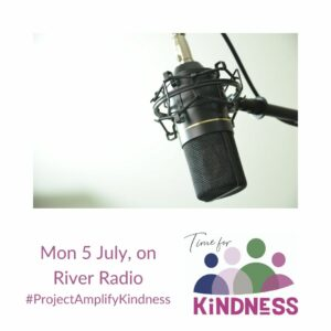A photo of a radio mic shown above the Time for Kindness logo, the date of the radio show and the hashtag for Project Amplify Kindness