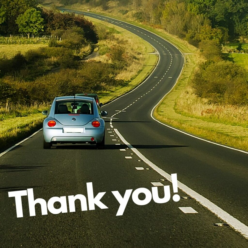 a blue car driving away along a winding road with the words thank you written below