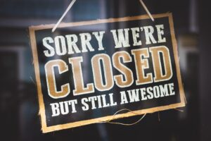 a community shop sign that says sorry, we're closed but still awesome